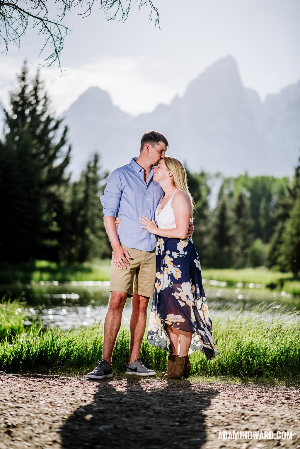 Couple kissing in front of the Tetons
